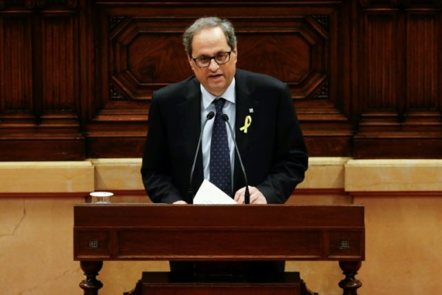 Independence advocate Quim Torra gives a speech at the Catalan's parliament as he stands for regional president