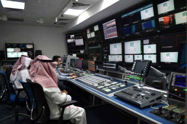 An employee works with trainees at SBC, a new channel under the umbrella of the Saudi Broadcasting Corporation in Riyadh, on April 24, 2018.