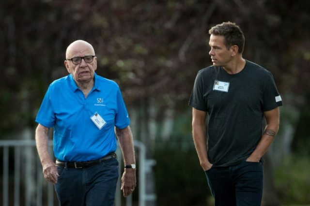 Rupert Murdoch and son Lachlan Murdoch, seen at a conference in 2017, share the title of executive chairman at News Corp, the newspaper-focus unit in the family's media empire