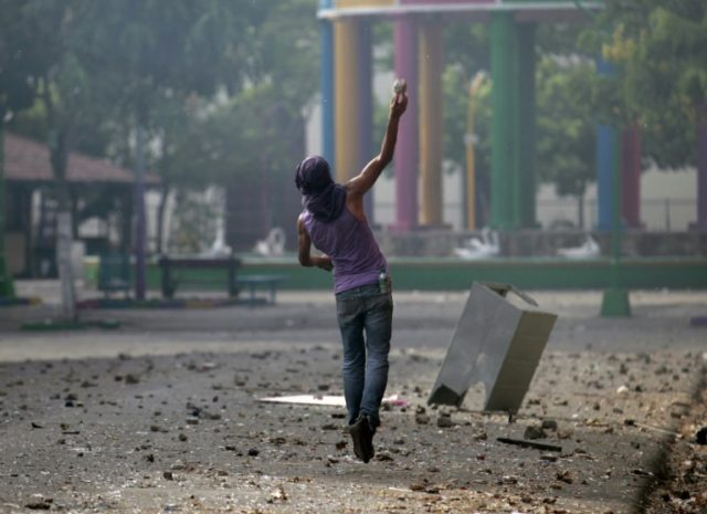 A Nicaraguan demonstrator clashes with riot police on May 12, 2018 in Masaya city, where a rights group and a doctor reported dozens injured