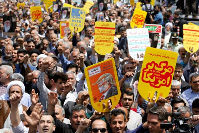 Iranians hold anti-US placards and shout slogans during a demonstration after Friday prayers in the capital Tehran on May 11, 2018