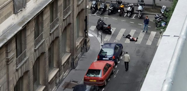A handout picture obtained on May 12, 2018, from the Twitter account of Wladia Drummond shows a man lying on the ground during a knife attack in central Paris, on May 12, 2018
