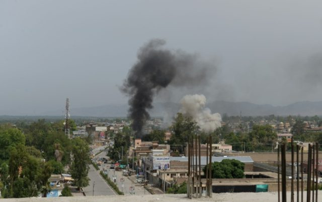 Smoke rises from a building during an ongoing attack in Jalalabad