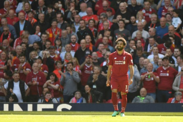 Liverpool's midfielder Mohamed Salah celebrates after scoring against Brighton and Hove Albion