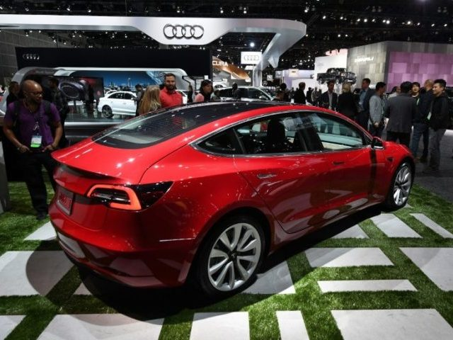 Tesla reorganizing to speed up production