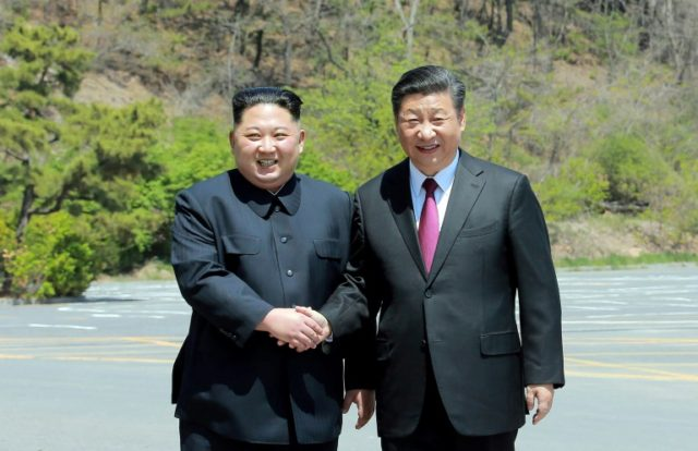 Xi Jinping (R) shakes hands with North Korean leader Kim Jong Un (L) in the Chinese city of Dalian earlier in May