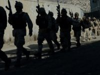 Afghanistan has sent commandos to battle the Taliban in Farah