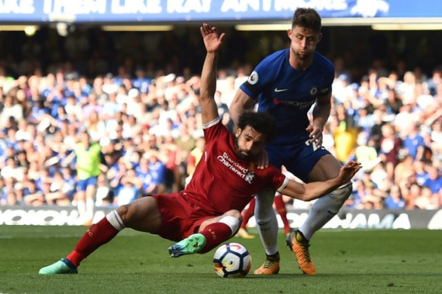 Liverpool's Egyptian forward Mohamed Salah (L) is to have a pair of boots donated to the British Museum after his record goalscoring exploits this season.