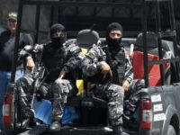 Venezuelan security forces are seen at the entrance of the intelligence service's Helicoide center in Caracas after opposition figures took control of a part of it
