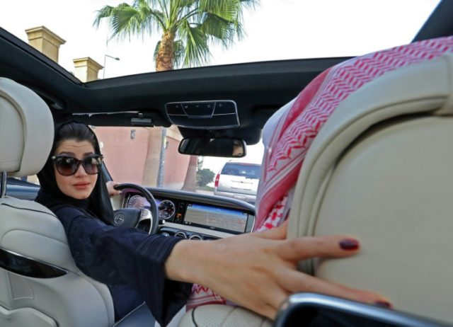 A Saudi woman practices driving in Riyadh, on April 29, 2018, ahead of the lifting of a ban on women driving in Saudi Arabia in the summer