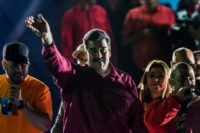 Venezuela's Nicolas Maduro waves to supporters after he was declared the winner of the presidential election