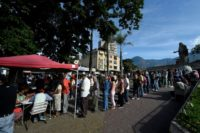 After voting in the election, people are registered under the red canopies in the hopes they will receive prizes promised by President Nicolas Maduro