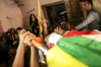 Relatives attend the May 19, 2018 funeral of Palestinian Moein Al-Saai, who died of wounds he sustained protesting at the Israeli-Gaza border