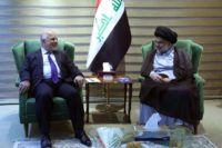 This handout picture released by the Iraqi Prime Minister's press office on May 20, 2018, shows Iraqi Prime Minister Haider al-Abadi meeting with Iraqi Shiite cleric and leader Moqtada al-Sadr in Baghdad