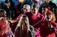 Nicolas Maduro (C) dances with supporters after he was declared the winner of Venezuela's presidential election