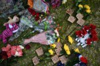 Flowers and memorials are placed on the grounds of Santa Fe High School, May 20, 2018 in Santa Fe, Texas, as federal investigators search for a motive in the deadly attack that killed 10 people two days ago in the rampage