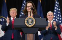 Gina Haspel (C) speaks after being sworn in as the Director of the Central Intelligence Agency alongside US President Donald Trump (L) and US Vice President Mike Pence (R)