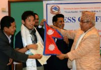 Photo taken in August 2015 shows Japanese climber Nobukazu Kuriki (2nd L) accepting a permit to climb Everest and a Nepalese flag from Nepal's tourism minister Kripasur Sherpa