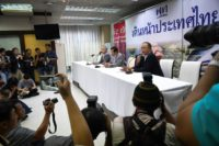 Pheu Thai party members Chusak Sirinul (R), Chaturon Chaisang (C) and Watana Muangsook (L) speak at a press conference last week before charges were filed
