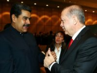Turkish President Recep Tayyip Erdogan and his Venezuelan counterpart Nicolas Maduro shake hands in December