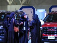 Saudi women check out cars at an automotive exhibition for women in the Saudi capital Riyadh on May 13, 2018