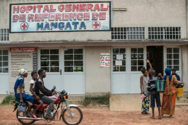 A motocycle drives past the entrance of the Wangata Reference Hospital in Mbandaka, northwest of DR Congo on May 20, 2018