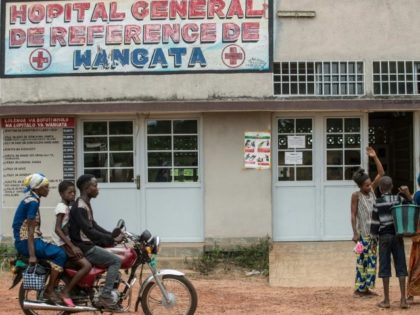 A motocycle drives past the entrance of the Wangata Reference Hospital in Mbandaka, northwest of DR Congo on May 20, 2018