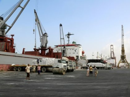 A crane unloads food aid provided by UNICEF from a cargo ship at the Red Sea port of Hodeida on January 27, 2018
