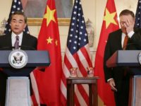 Chinese Foreign Minister Wang Yi (L) warned against the case being 'politicised' while Mike Pompeo (R) said it was 'very similar' to what happened in Cuba