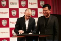Spain legend Andres Iniesta signs his Vissel Kobe contract watched by club owner Hiroshi Mikitani