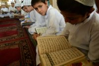 Afghan students recite from the Quran in a mosque during the Muslim holy month of Ramadan in Jalalabad