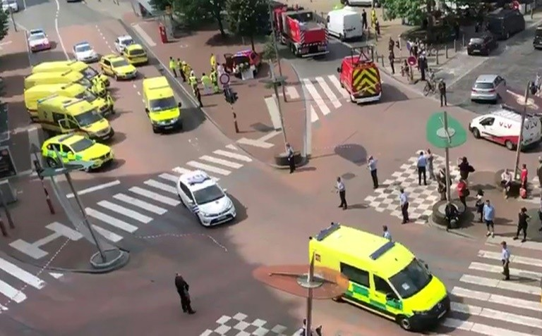 This video grab from the Twitter account of Victor Jay shows police and emergency services blocking a crossroads in the Belgian city of Liege, after a gunman killed three people including two female officers