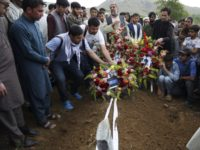 Thousands attend memorial for slain Afghan photographer