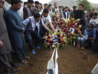 Thousands attend memorial for slain Afghan photographer