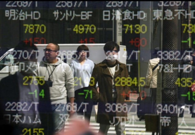 London, Tokyo stocks higher in quiet May Day trading