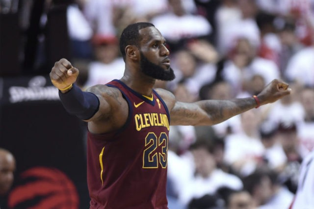 James has triple-double, Cavs beat Raptors in OT in Game 1