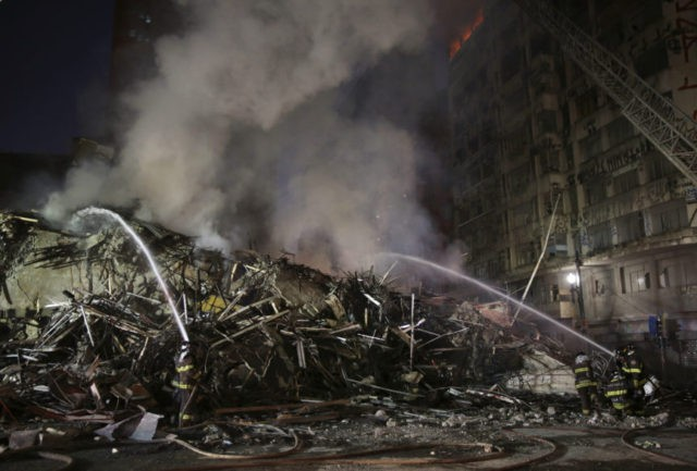 Burning building in Sao Paulo collapses; at least 1 dead
