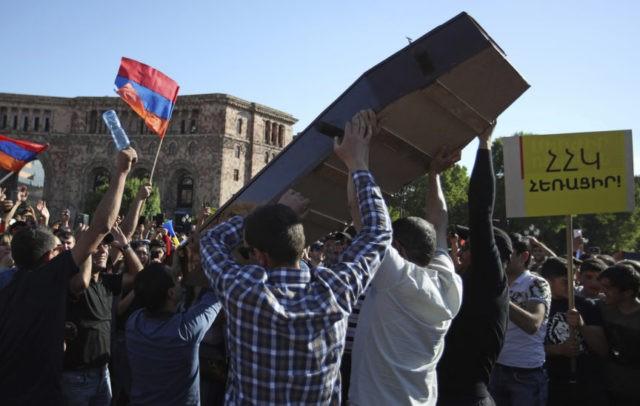 The Latest: Coffin protest held in Armenia's main square