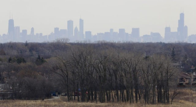 In this March 19, 2015, file photo, a thick haze of smog looms over the skyline of Chicago. A new study in the Proceedings of the National Academy of Sciences finds that America's nitrogen oxides levels, a key ingredient in smog, aren't falling as fast as they used to and …