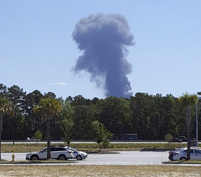 Military plane crashes near airport in Georgia