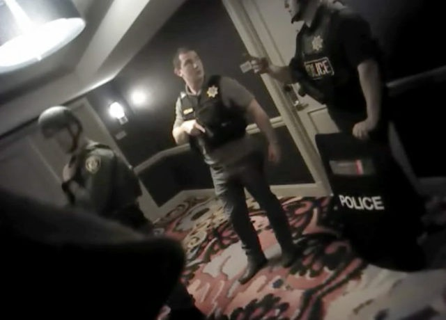 Video: Police inspect wires, weapons in Vegas shooter's room