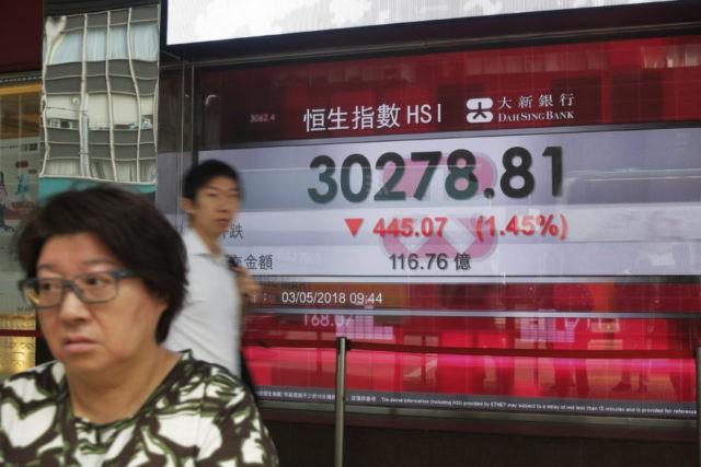 World shares mixed as markets mull Fed, China trade talks