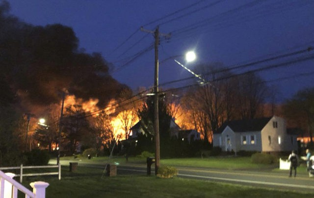 The Latest: Woman held hostage, escaped before explosion