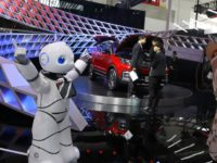 "In this April 26, 2018, photo, a robot entertains visitors at the booth of a Chinese automaker during the China Auto 2018 show in Beijing, China. Under President Xi Jinping, a program known as ""Made in China 2025"" aims to make China a tech superpower by advancing development of industries …"