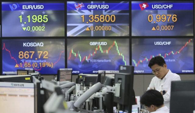 Global stocks mixed ahead of US jobs data, amid trade talks