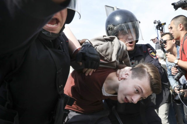 The Latest: Russia arrests over 350 in anti-Putin protests