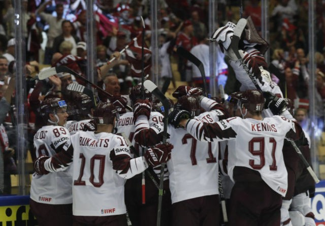 Latvia comes back to beat Norway in worlds, US faces Denmark