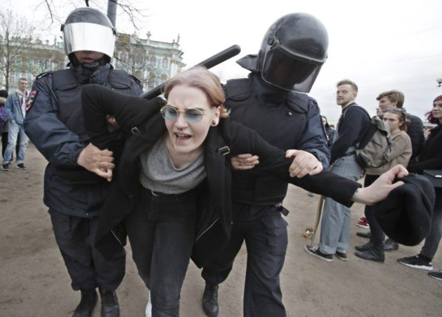 The Latest: Over 1,000 arrested in anti-Putin protests