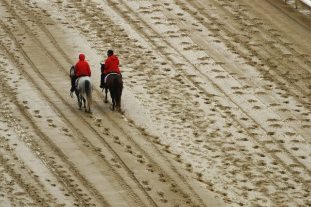 The Latest: Track at Churchill Downs downgraded to sloppy