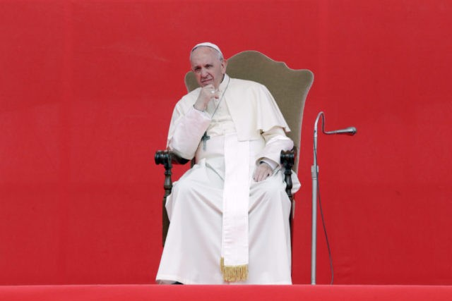 Pope Francis sits during a meeting with faithful on the occasion of the 50th anniversary of the Neocatechumenal Way, one of the Catholic Church's biggest missionary movement, in the esplanade of Tor Vergata neighborhood in Rome, Saturday, May 5, 2018. Pope Francis is urging the missionary movement to respect different …
